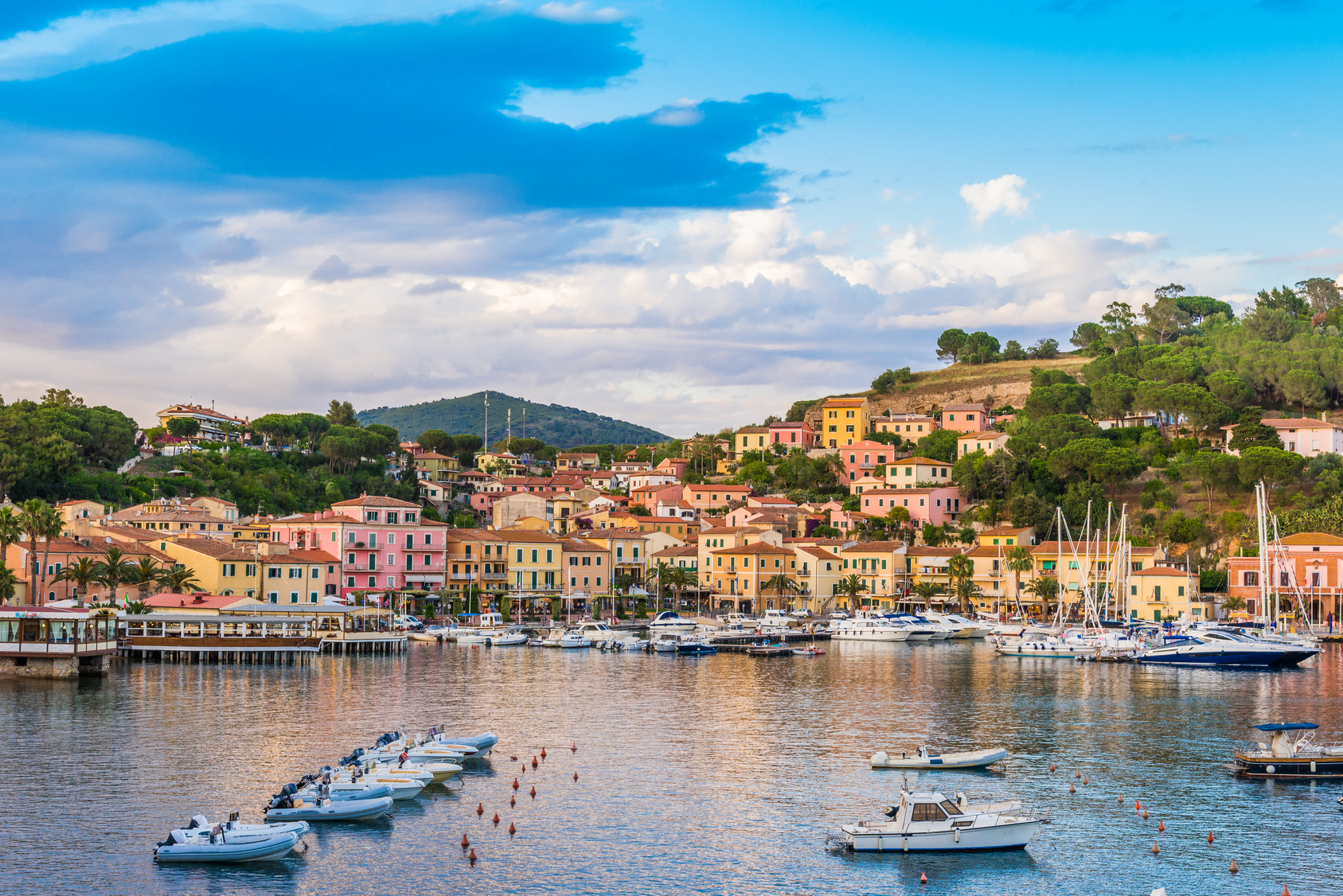 Panoramic view over the famous attraction port of Porto Azzurro at sunset, in Italy - Elba island
